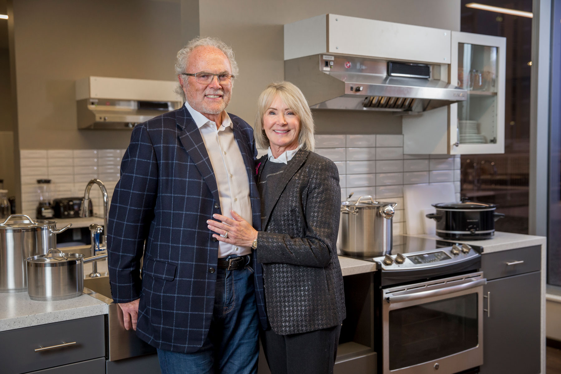 Gary and Christine Rood stand in the community kitchen at the Rood Family Pavilion