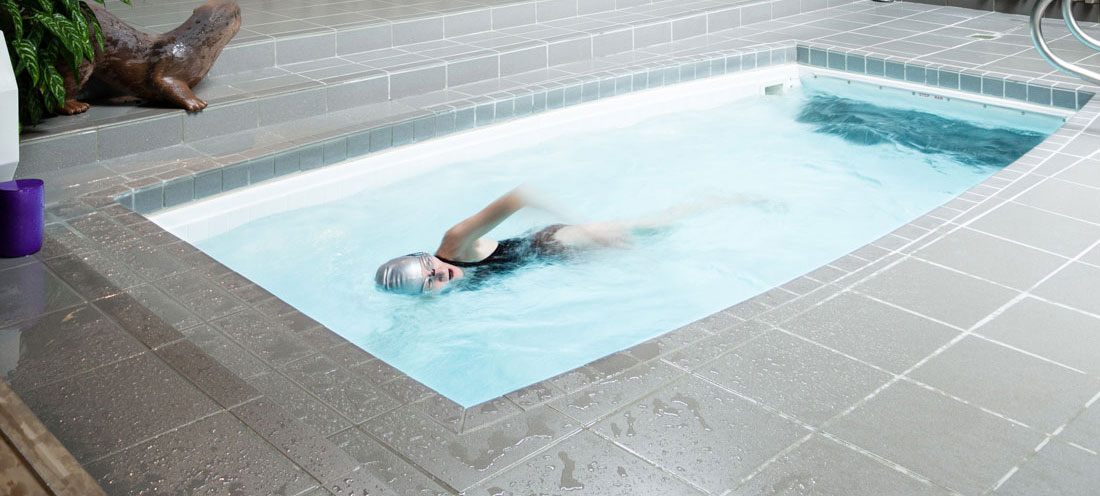 Anne Foster swimming in a small lap pool