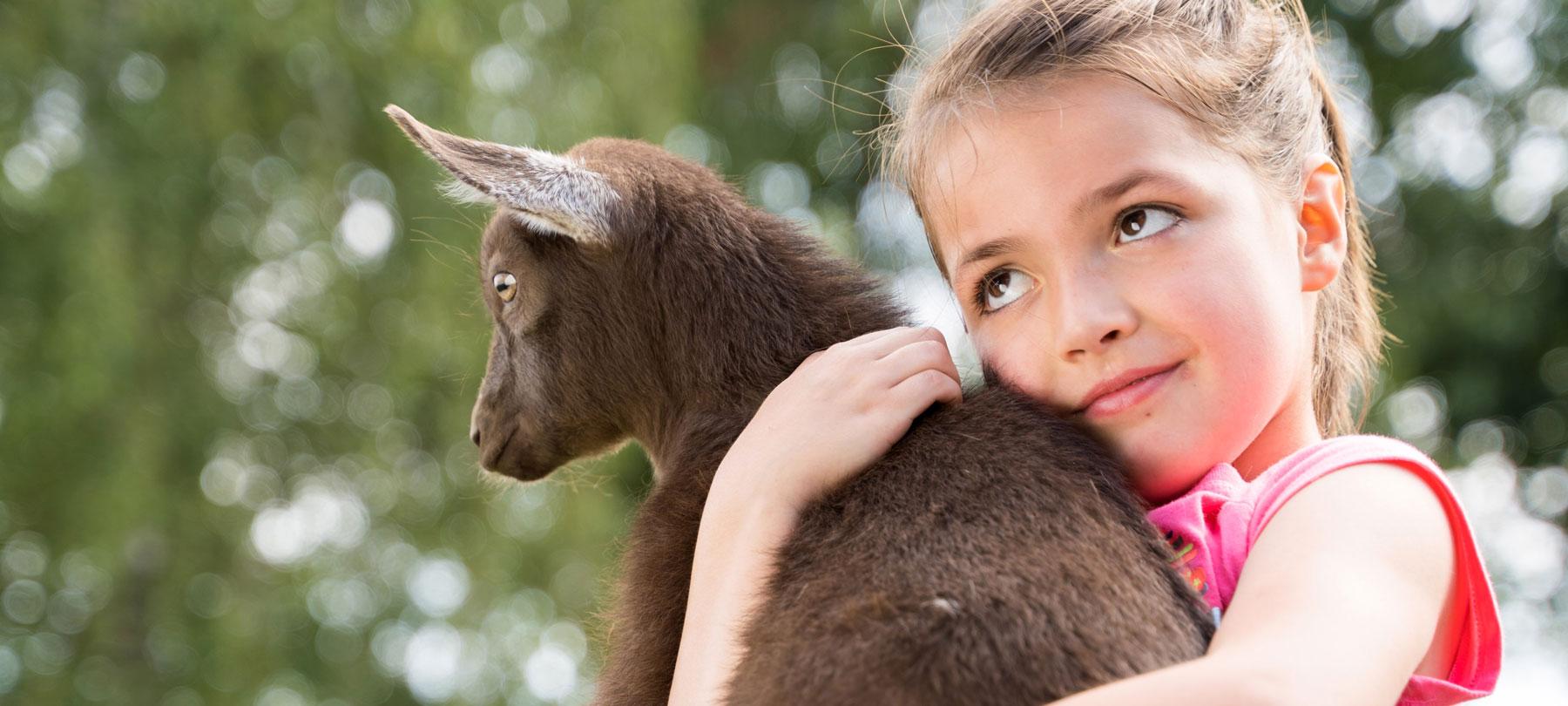 Ella holds a baby goat