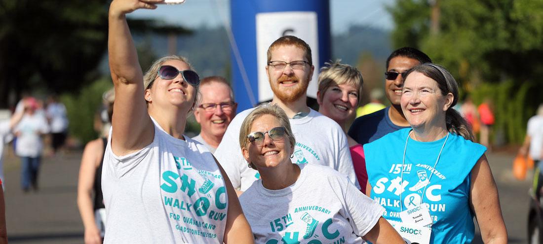 People in a fun run pose for a selfie