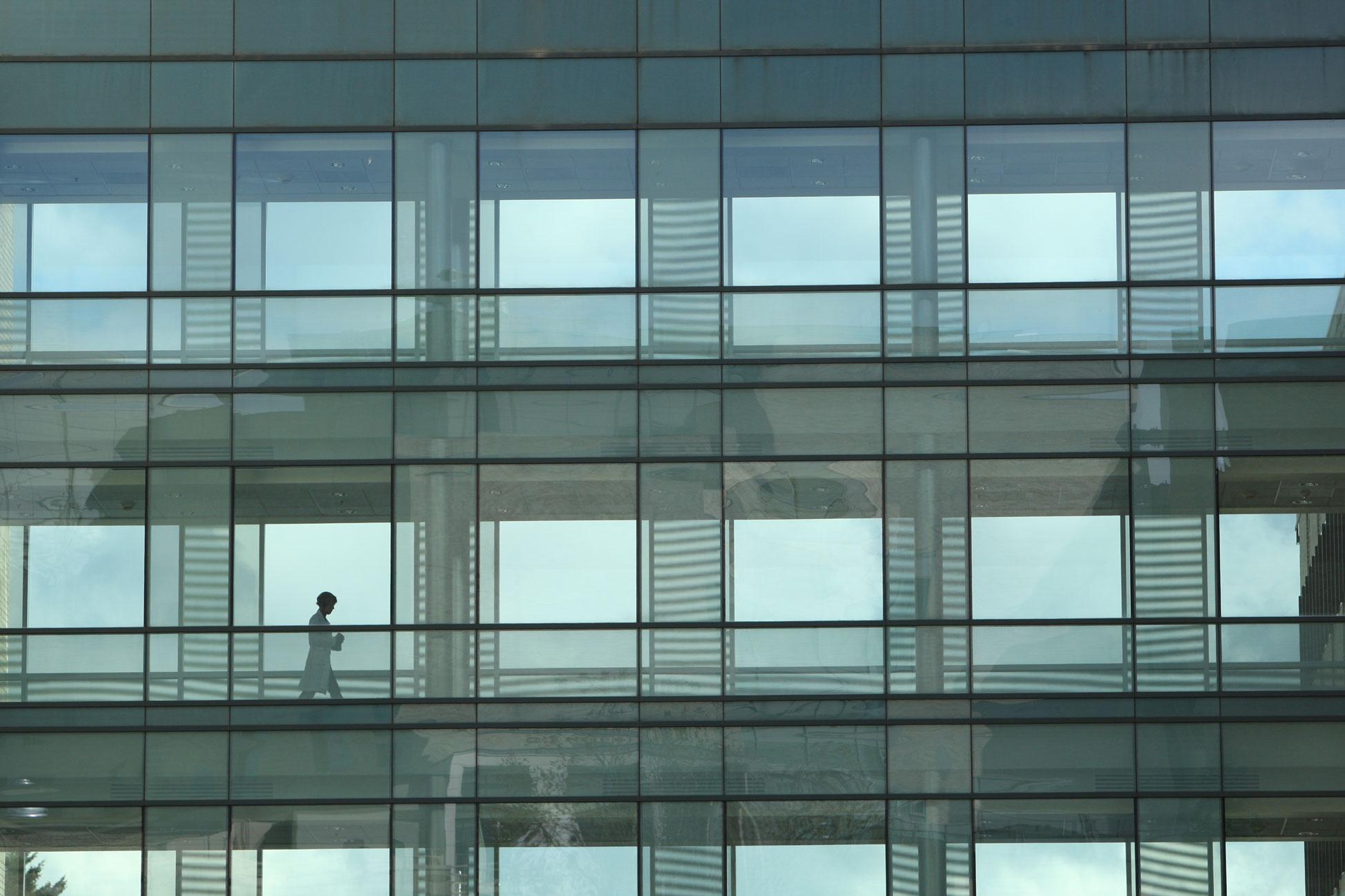 A person walking across the BICC bridge