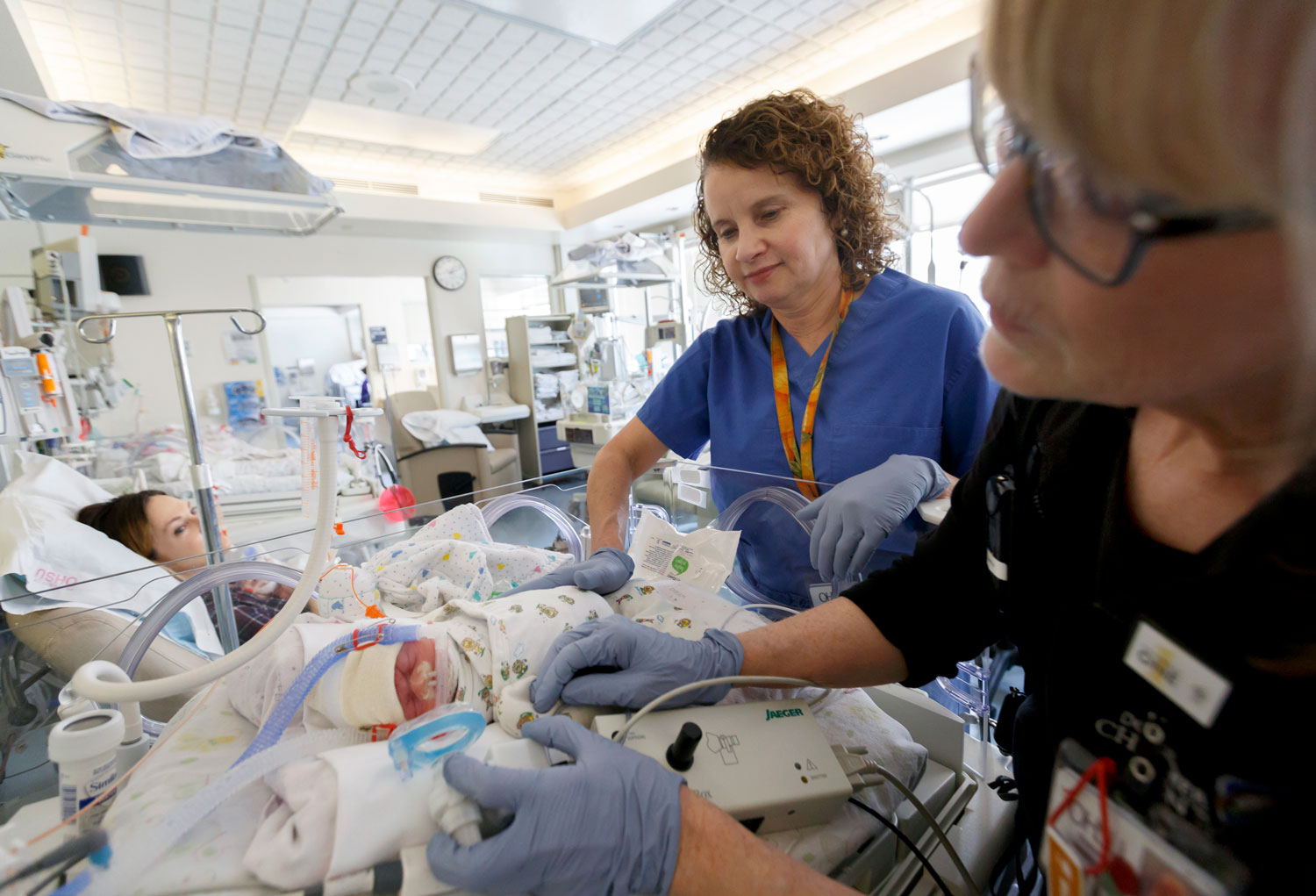 Doctor Cindy McEvoy working with a baby in the NICU