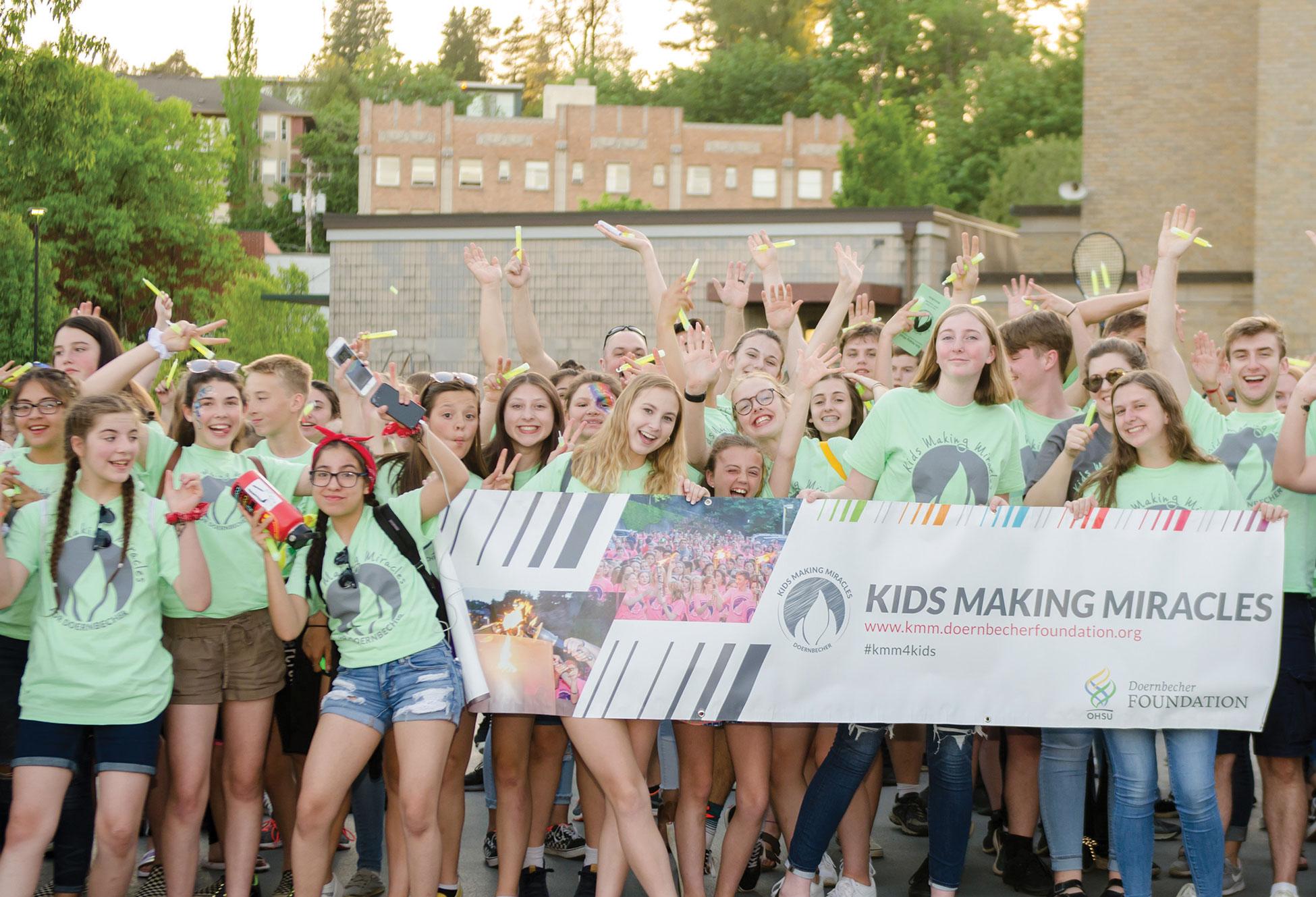 Students celebrate at Kids Making Miracles candlelight vigil