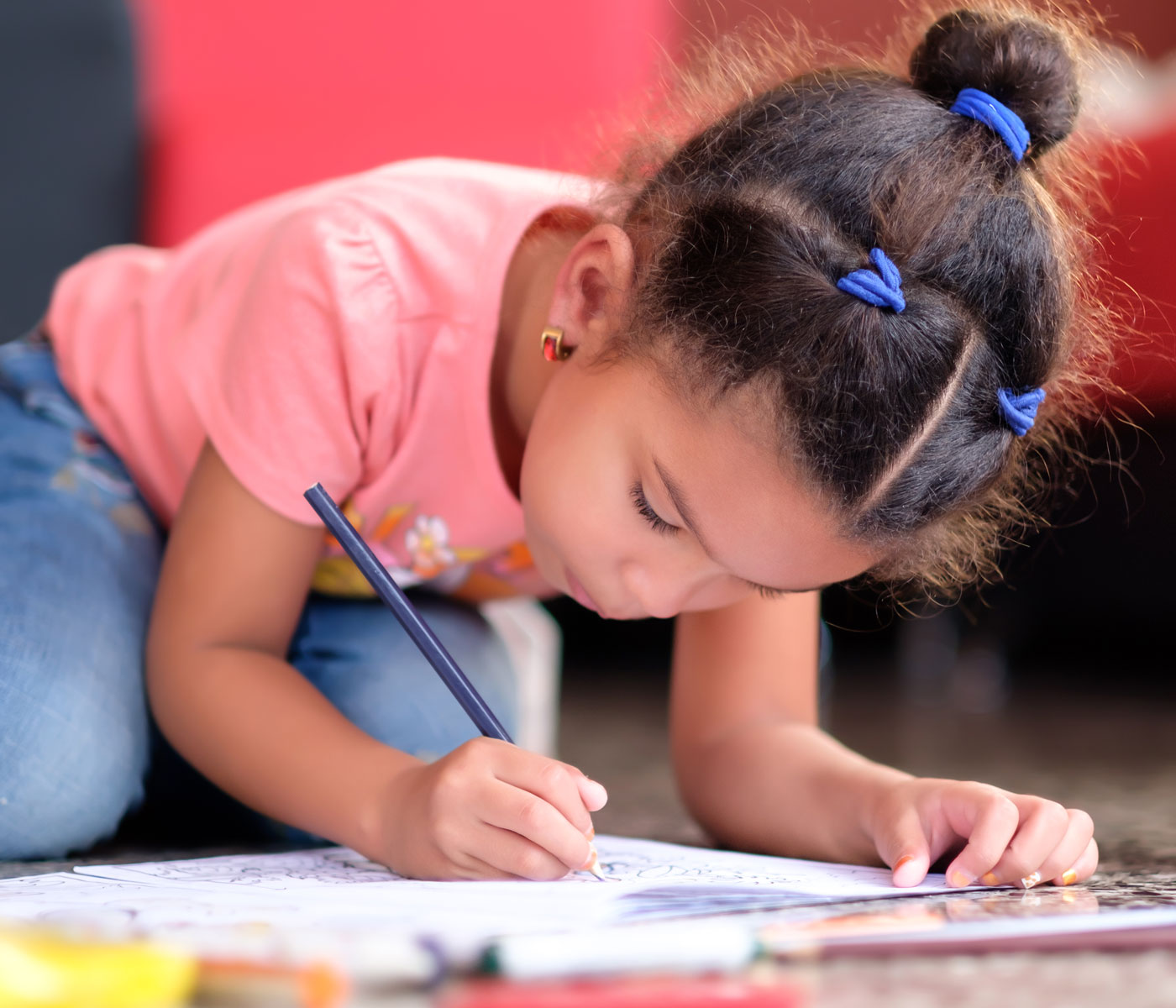 Little girl drawing very intently
