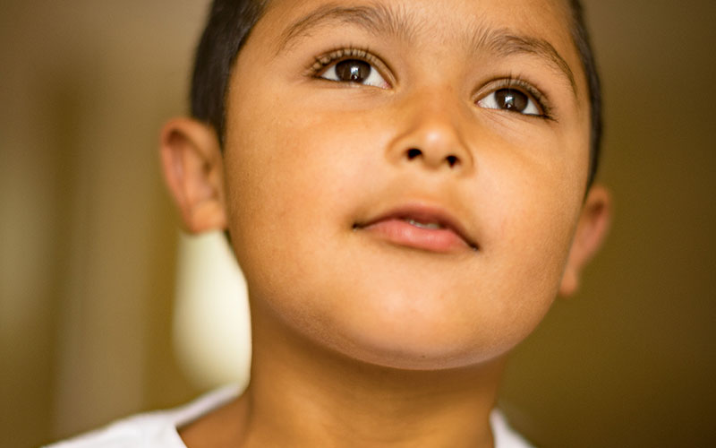 Young Boy Staring with Hopeful Expression