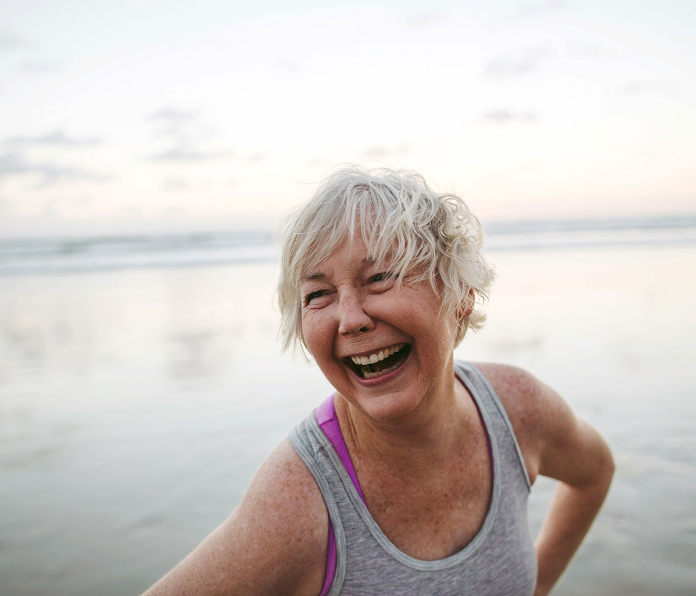 Smiling Older Woman on the Beach