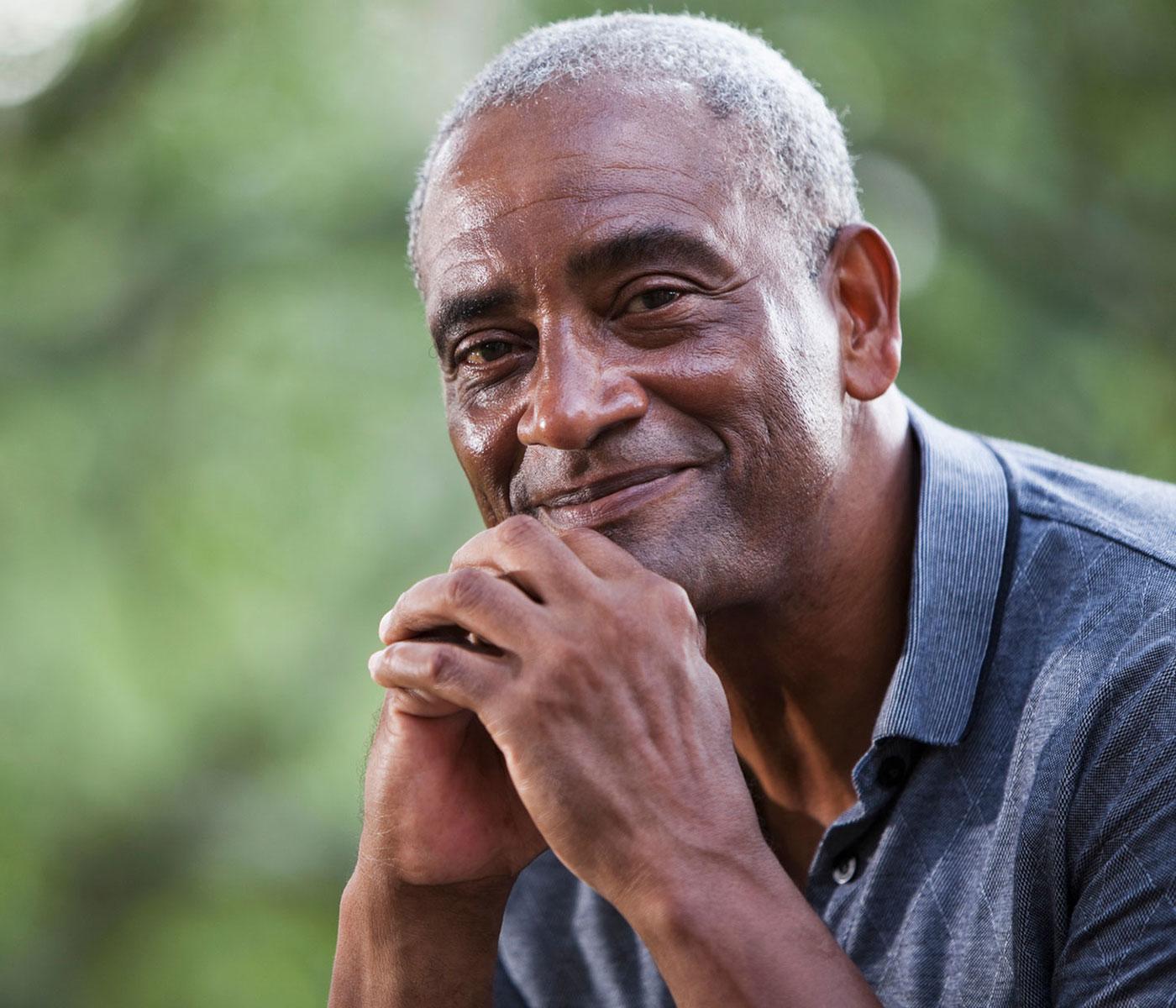 Older Black Man Smiling at Camera