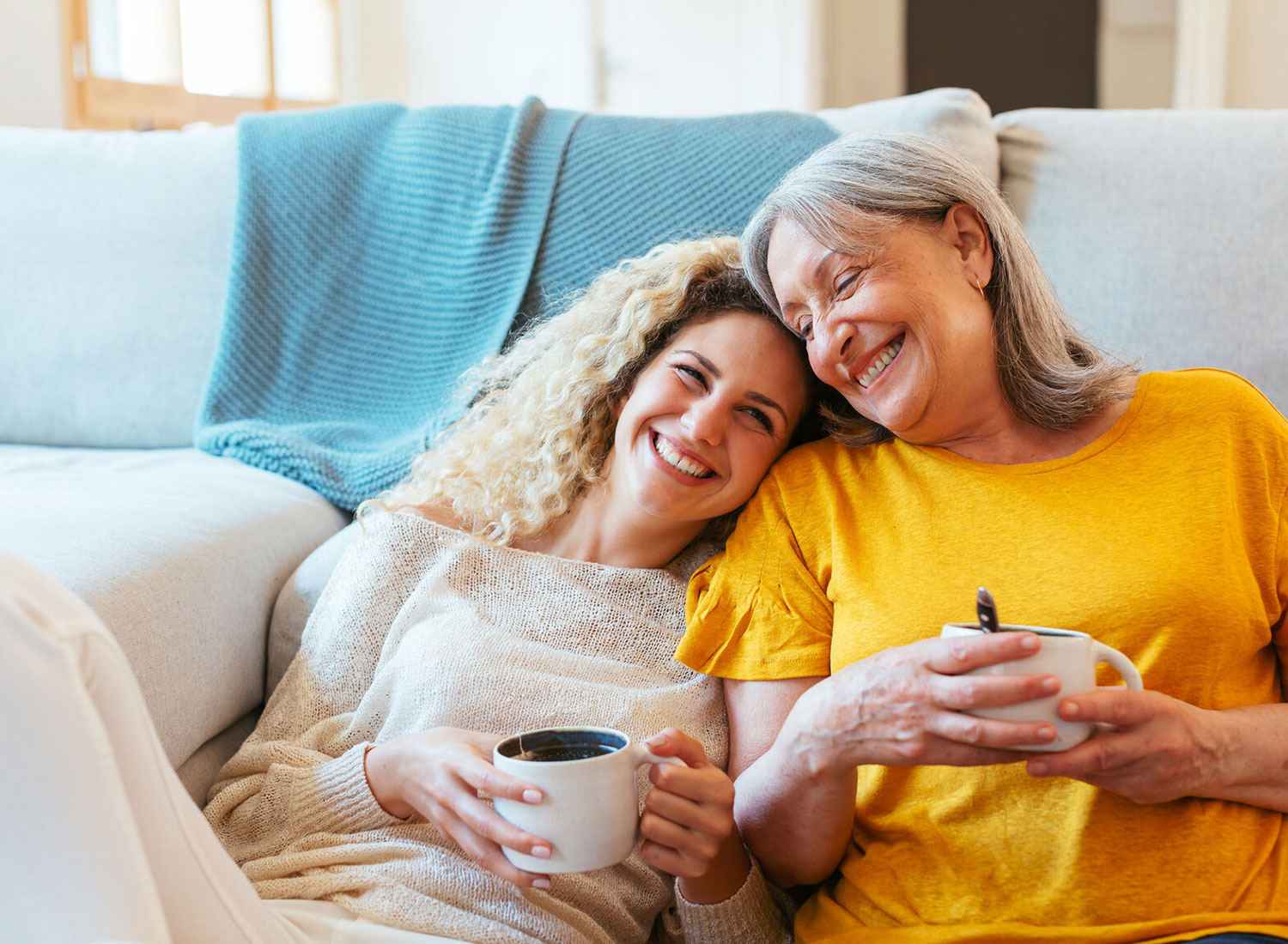 Two Woman Smiling and Drinking Tea