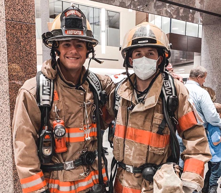 Matt in a firefighter uniform