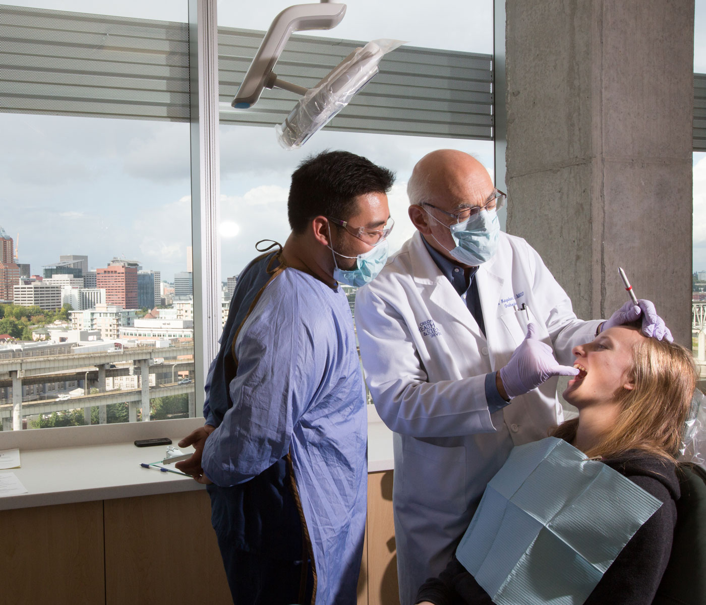 Student and faculty treating a patient at the School of Dentistry