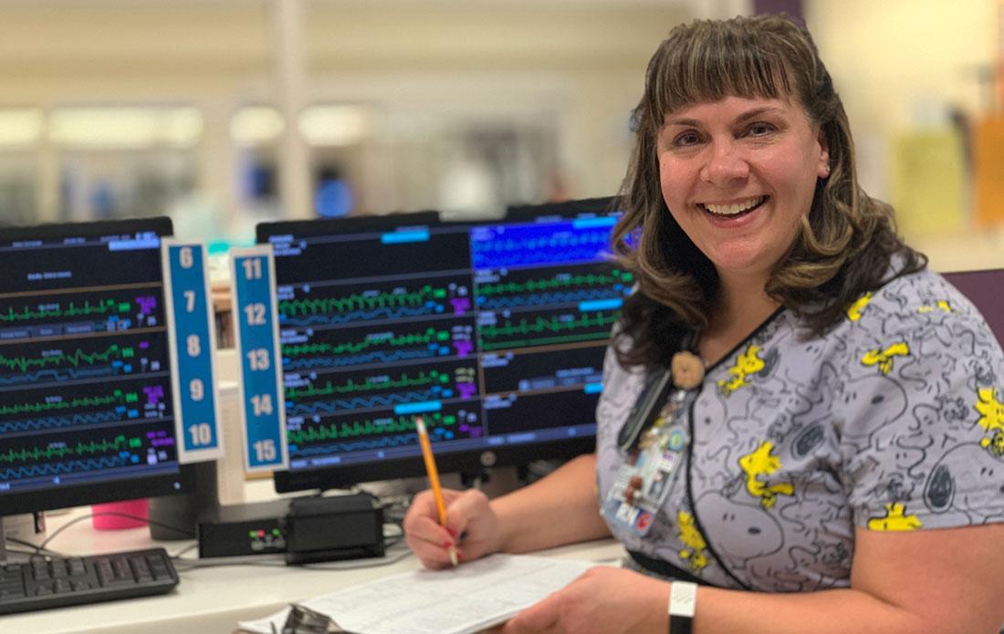 Nurse Leo Eskola works next to computer monitors