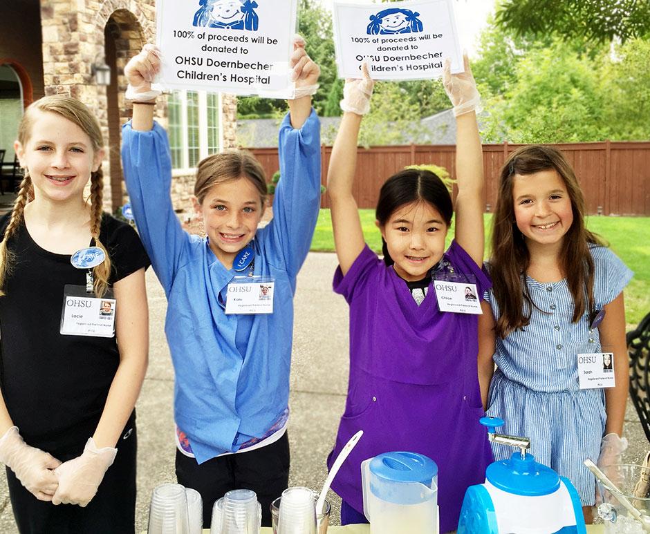 Little girls selling lemonade