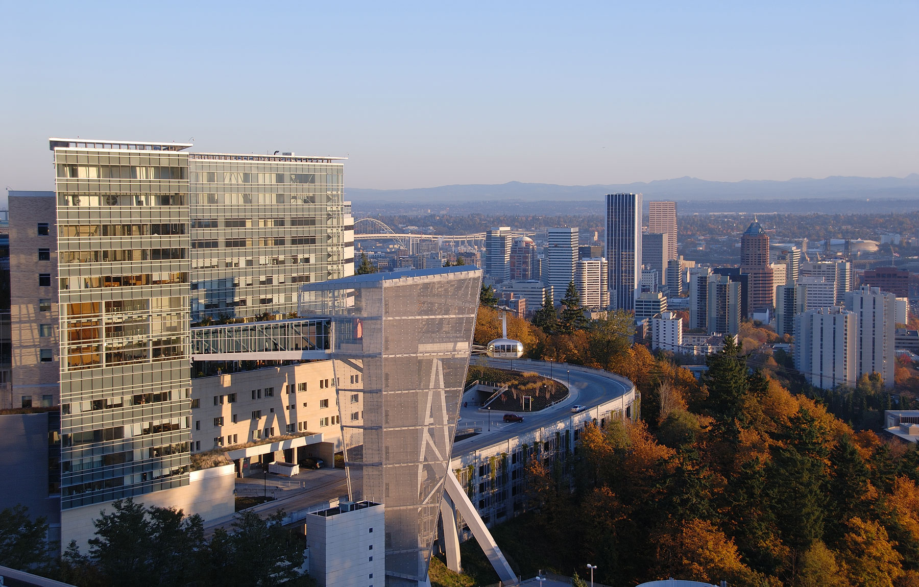 OHSU Kohler Pavilion and tram with city of Portland in the distance